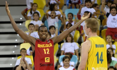 Angola centre Yanick Moreira celebrates next to Australia's forward Brock Motum during their Basketball World Cup clash in Spain.